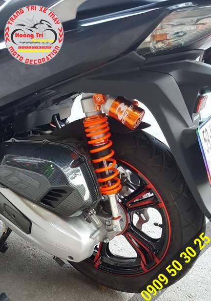 Mâm kuni kết hợp cùng phuộc sau bình dầu Racing Boy
