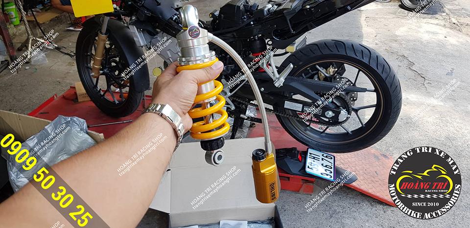 Ohlins oil bottle is prepared to install for Winner X