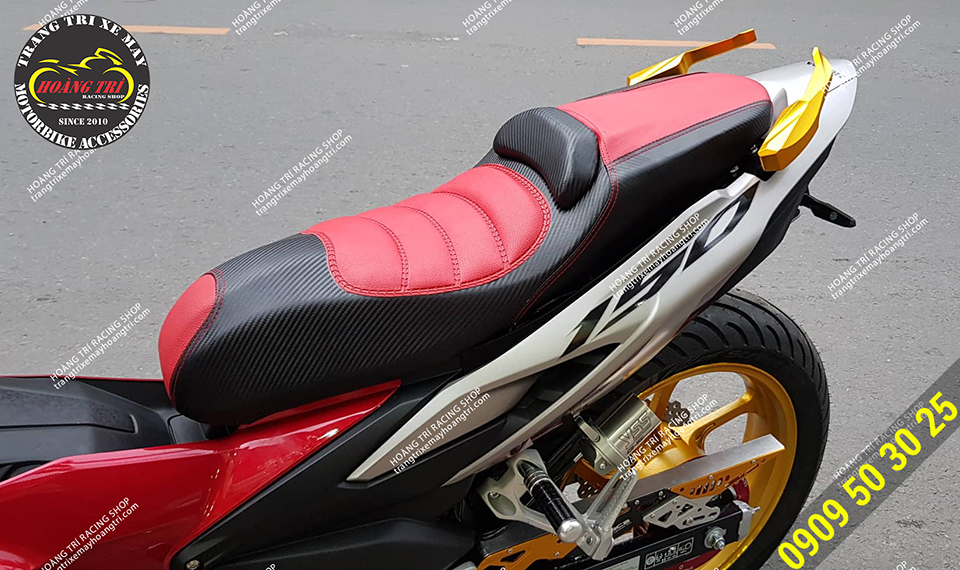 Red and black double-decker saddle has been installed for Winner X
